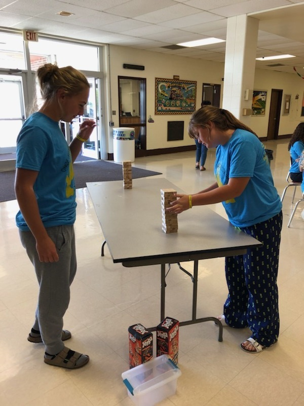 Two HHS students playing Jenga as a Suicide Awareness activity at lunch.